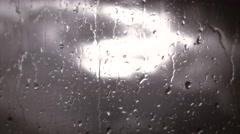 Rainy days,Rain drops on window,rainy weather,rain background,rain and bokeh Stock Footage