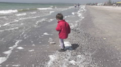 Boy walking on a winter beach Stock Footage
