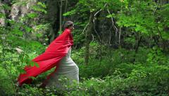 Beautiful red riding hood walking in forest, super slow motion, 240fps HD - stock footage