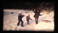 Two girls and mother, winter fun, snowball fight in snow vintage 8mm film - stock footage