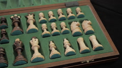 Chess. Open box with chess pieces. Panorama in motion. Stock Footage