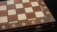 Chess. Box of chessmen. Chess pieces. Open the cover of the chess box Board. Stock Footage