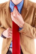 Adjusting red tie Stock Photos