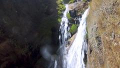 Exotic Waterfall runs through Mediterranean valley Stock Footage