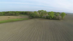 Over the opened rural  field and lake. Aerial Stock Footage