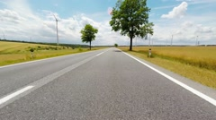 Rural road and wind turbines Stock Footage