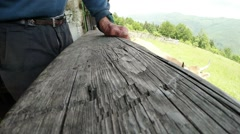 Hand old grandfather on wooden support Stock Footage