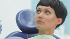 Dentist before treatment makes recommendations on dental care for the patient Stock Footage