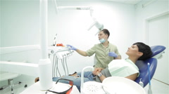 Dentist includes a lighting fixture before dental treatment Stock Footage