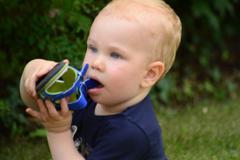 child holding a sandal - stock photo