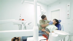 Dentist teeth ending inspection patient view general - stock footage