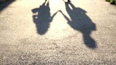 Shade of a young couple in love on the pavement. Silhouette of two people Stock Footage