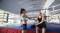 Young girl athlete comes to fitness instructor and takes his hand to shake Stock Footage