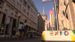 MIlan, bicycles at Vittorio Emanuele and Expo 2015 Banner Stock Footage