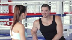 Seated fitness instructor and a young girl athlete discussing the program Stock Footage
