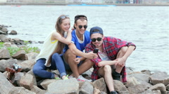 Friends meeting. Threesome gay friends make selfie riverside - stock footage