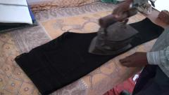 Indian man working  with antique clothes iron Stock Footage
