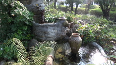 Beautiful fountain in asia buddhist temple garden Stock Footage