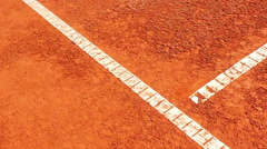Chair umpire checking mark on clay court Stock Footage