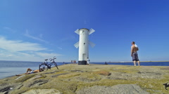 White old lighthouse in Swinoujscie, Poland Stock Footage