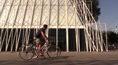 Cyclists and Expo gate 2015 Pyramid Stock Footage