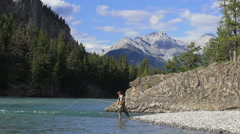 Canada Alberta Banff Bow River fly fisherman casts 2 Stock Footage