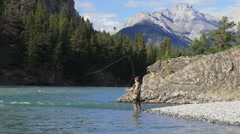 Canada Alberta Banff Bow River fisherman flicking fly rod 4 Stock Footage