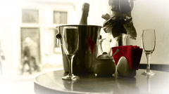 Cute dating black and white scene. Champagne in bucket with glasses. Stock Footage