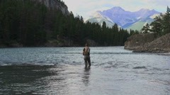 Canada Alberta Banff Bow River fisherman wading and mountain 7 Stock Footage