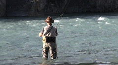 Canada Alberta Banff Bow River fisherman casts into rapids 8 Stock Footage