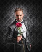 give a rose on the anniversary - stock photo