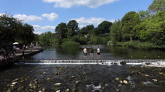 Children On Stepping Stones - River-Summer Stock Footage