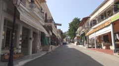 Street with Souvenirs shops in a village, Greece. Shopping day. Stock Footage