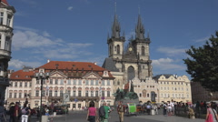 Tourist people visit Old Town Prague city famous landmark public square blue sky Stock Footage