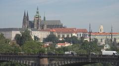 Panorama Prague castle traffic car bridge landmark iconic place sunny day people Stock Footage