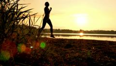 Woman Jogging at Sunrise Stock Footage