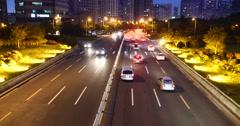4k Modern urban city busy traffic jams night,neon highway street&building. Stock Footage
