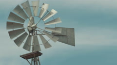 Old fashioned Windmill / Wind mill spinning in the wind. Stock Footage