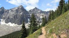 Canada Alberta Banff Eiffel Lake Trail hiker stops to observe cliffs 19 Stock Footage