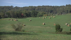 large farm vista and hay bales wide shot - stock footage
