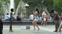 jump rope and double dutch in Washington Square Park in Manhattan New York City - stock footage