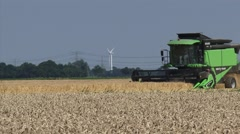 Combine harvester Deutz 6060 in the northern sea clay area of The Netherlands Stock Footage