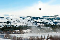 Colorful hot air balloon flying in the blue sky Stock Photos