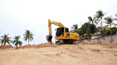 Excavator in Action on the Beach. Stock Footage
