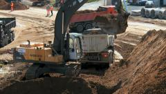 Construction site of a highway- crane and dump truck Stock Footage