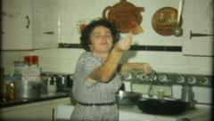 1136 - Italian mother cooks for the family - vintage film home movie - stock footage