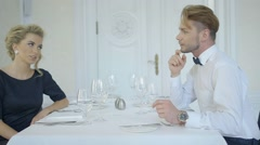 Young attractive couple at luxury restaurant Stock Footage