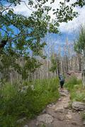 Female hiker on the cub lake trail in rocky muntain national park Stock Photos
