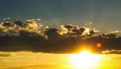 Inspiring golden sunset sky timelapse sun shining rays through clouds Stock Footage