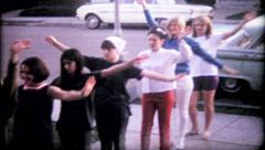 1132 - girls practice their cheerleading in suburbia - vintage film home movie Stock Footage